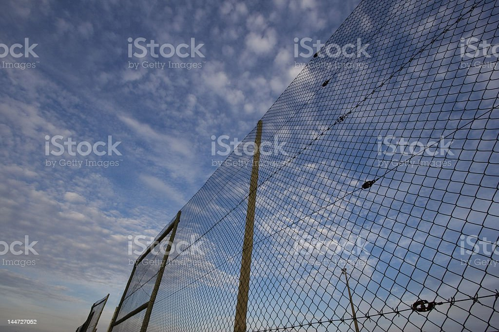 Fence over sky royalty-free stock photo