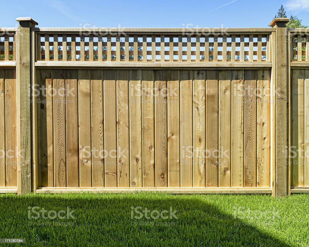 Fence panel placed in a yard for safety stock photo