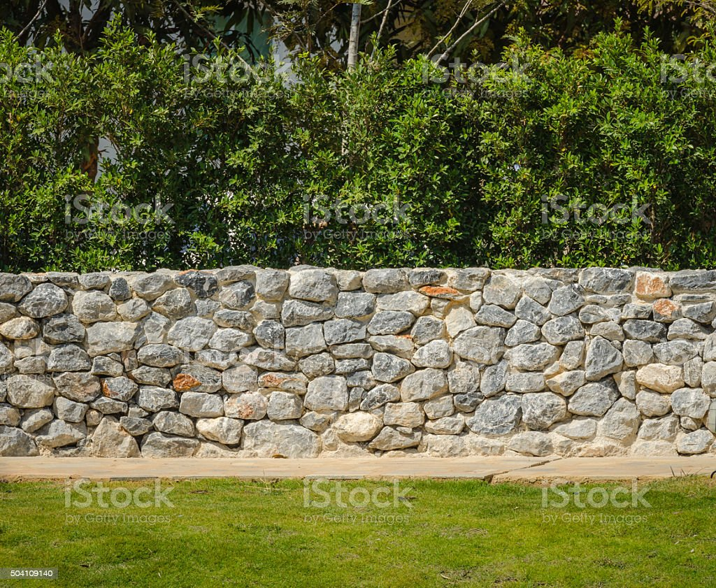 fence real stone wall surface with cement stock photo