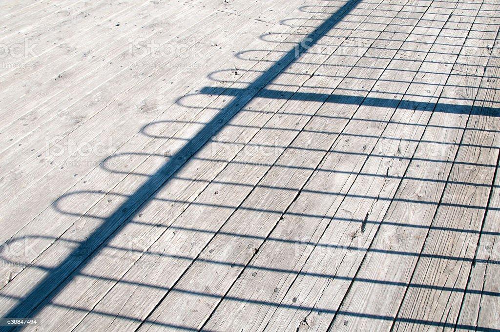Fence shadow stock photo