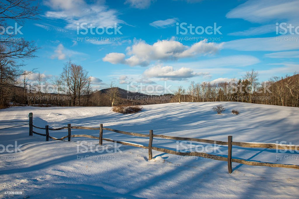 Fence, snow, trees and clouds in Vermont. stock photo