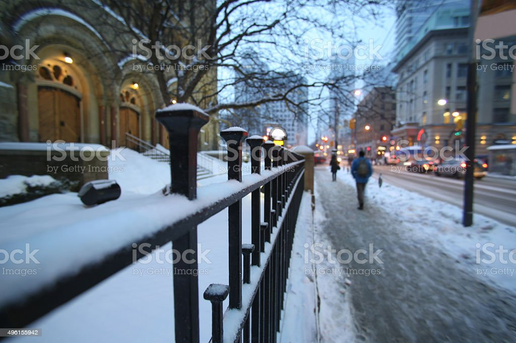 fence street in snowstorm stock photo