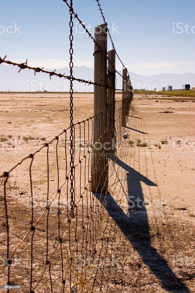 Fence Under Clear Skies stock photo