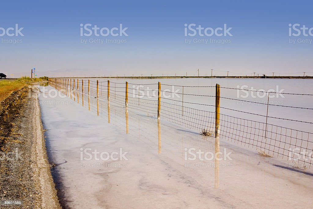 Fence Under Clear Skies royalty-free stock photo