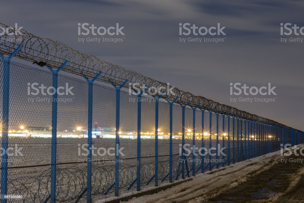 Fence with barbed wire, restricted area stock photo