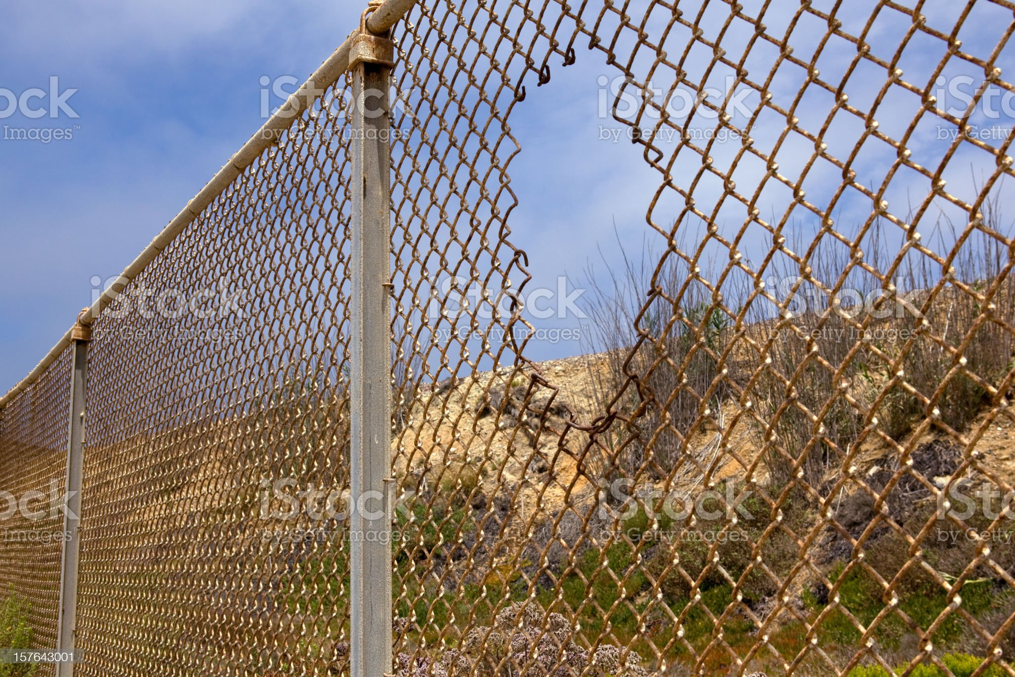 Fence with hole royalty-free stock photo