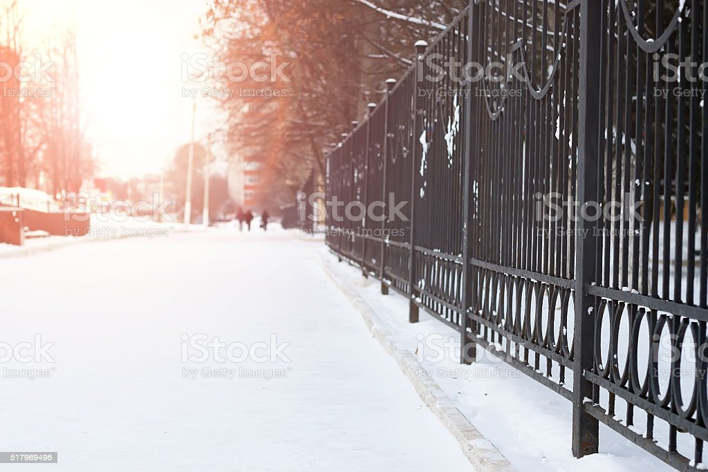 fence with the sun peaks stock photo