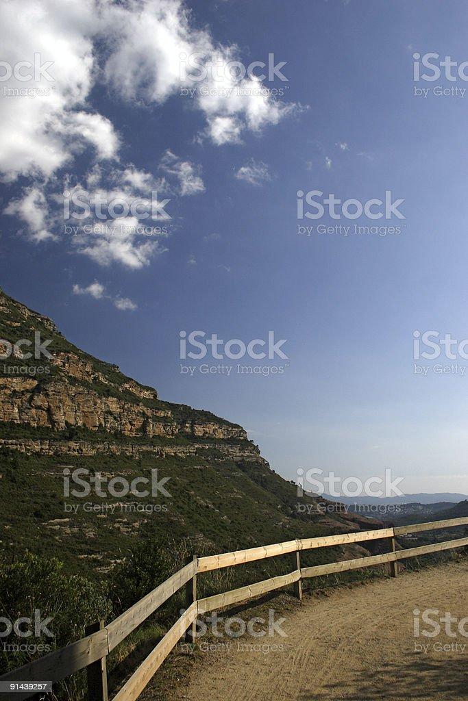 fenced mountain path stock photo