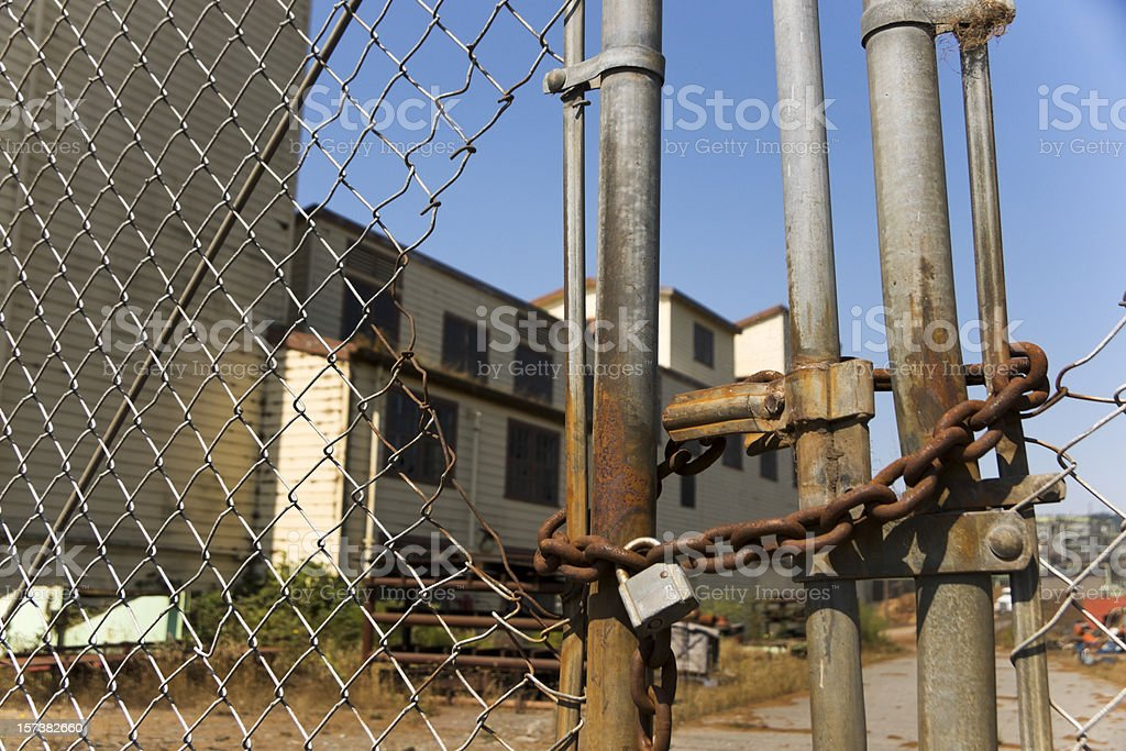 Fenced off Abandoned Factory royalty-free stock photo
