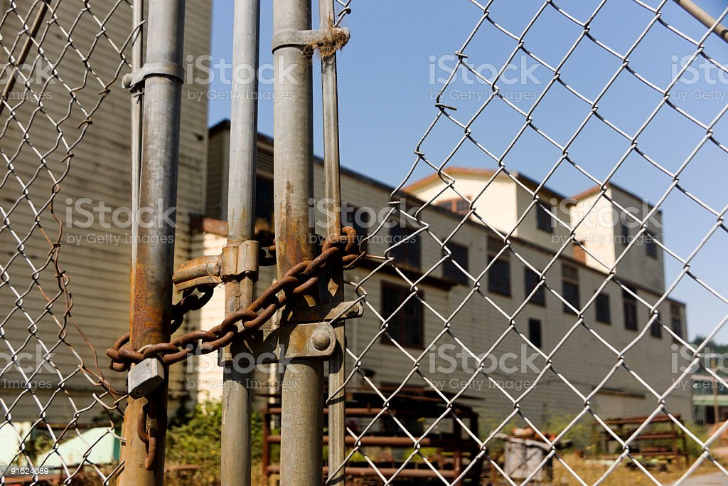 Fenced off Abandoned Factory stock photo
