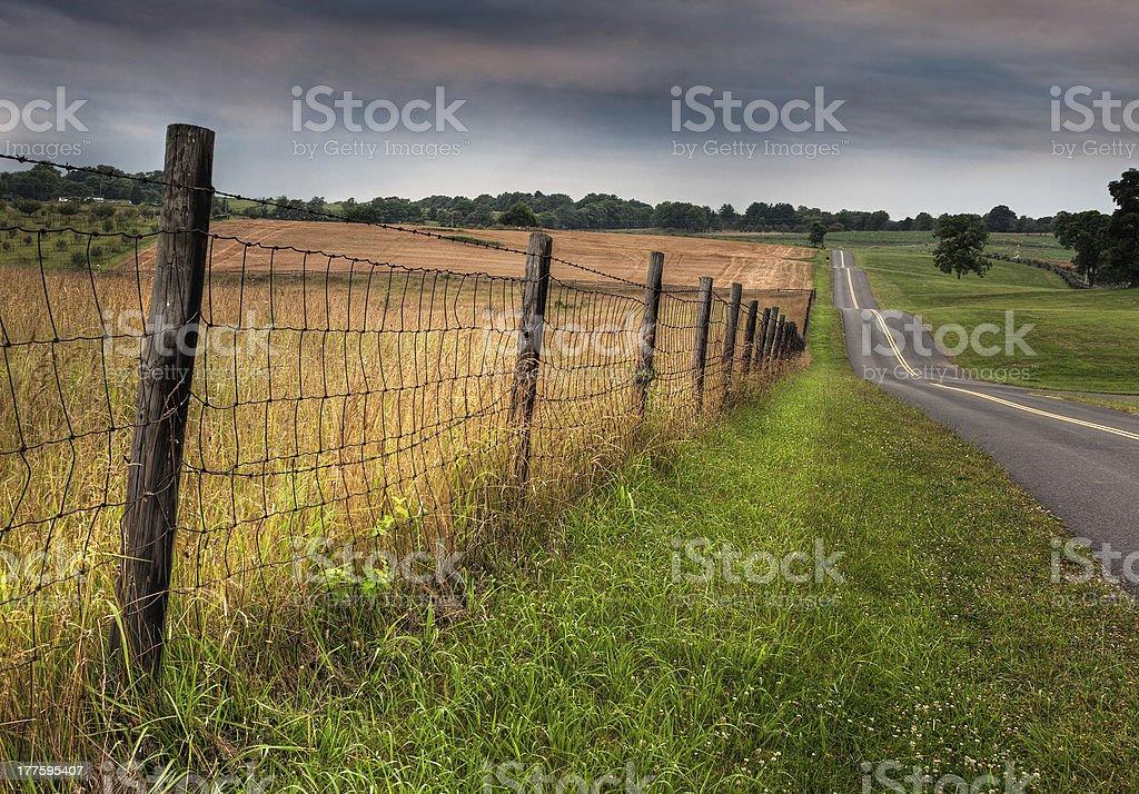 Fenceline and Road stock photo