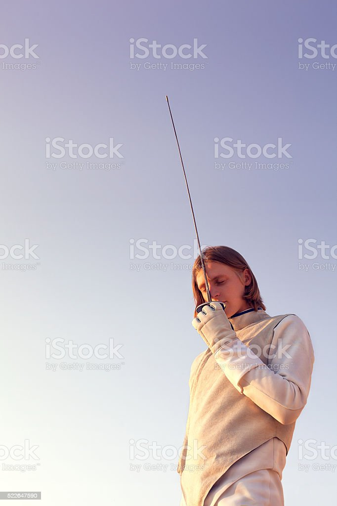 Fencer man with sword stock photo