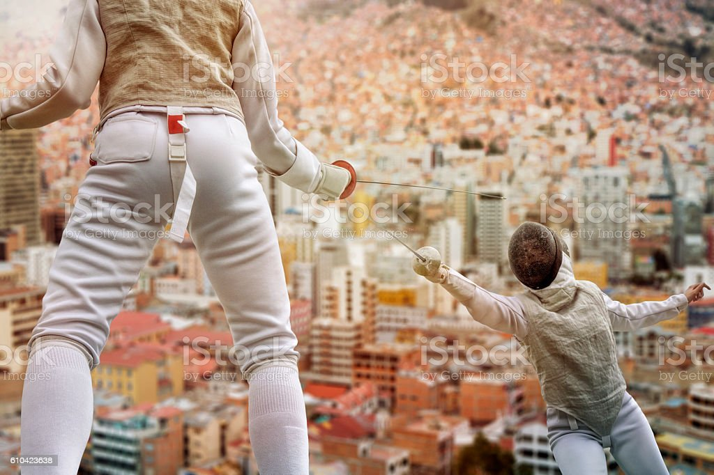 Fencers above the roofs of the city stock photo