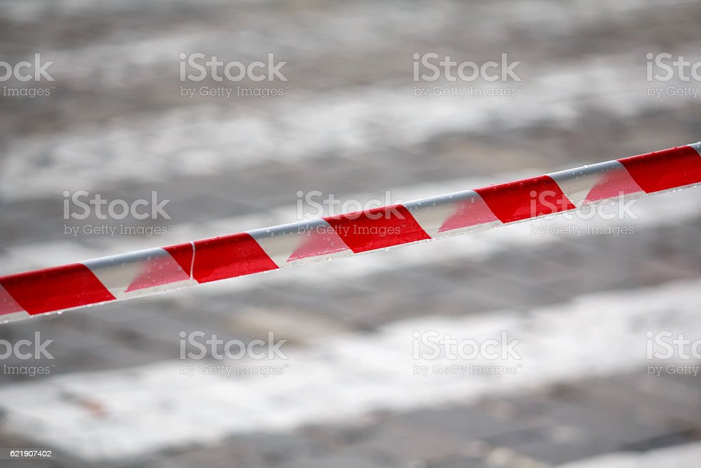 Fencing red and white ribbon which prohibits movement. Danger stock photo