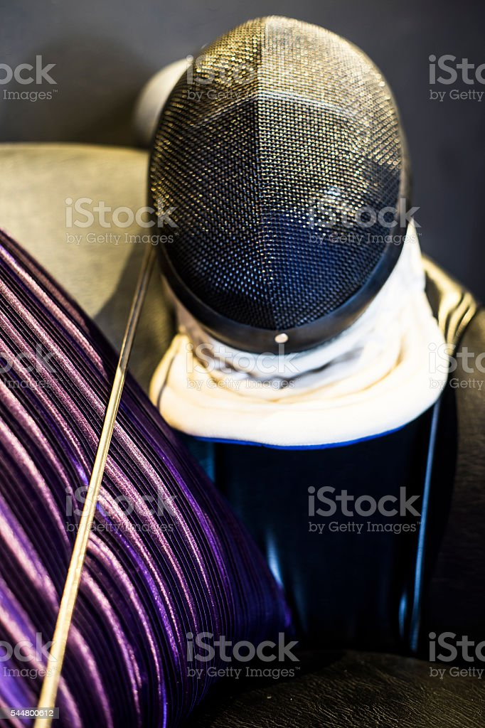 Fencing sword and helmet royalty-free stock photo