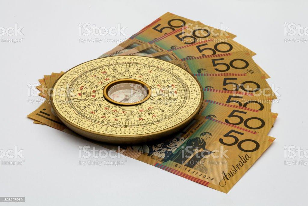 Feng Shui Campass against Astralian Money stock photo