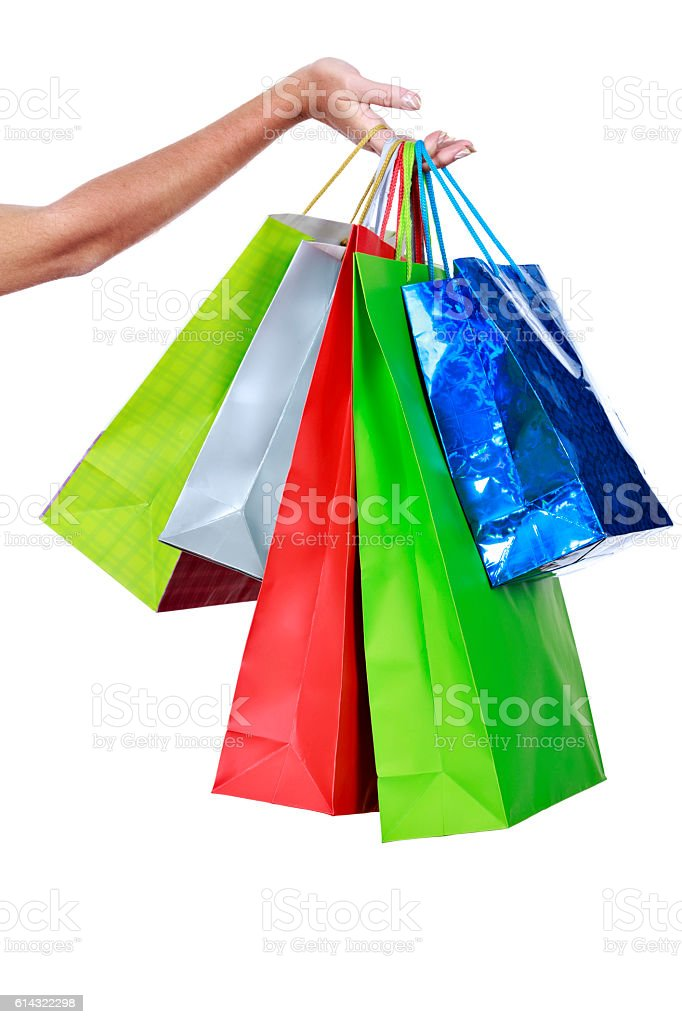 Fenmale hand holding group of shopping bags stock photo