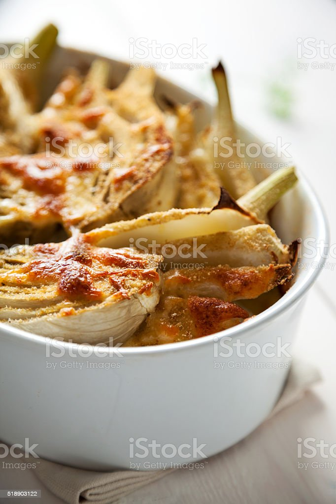 fennel gratin with mozzarella stock photo