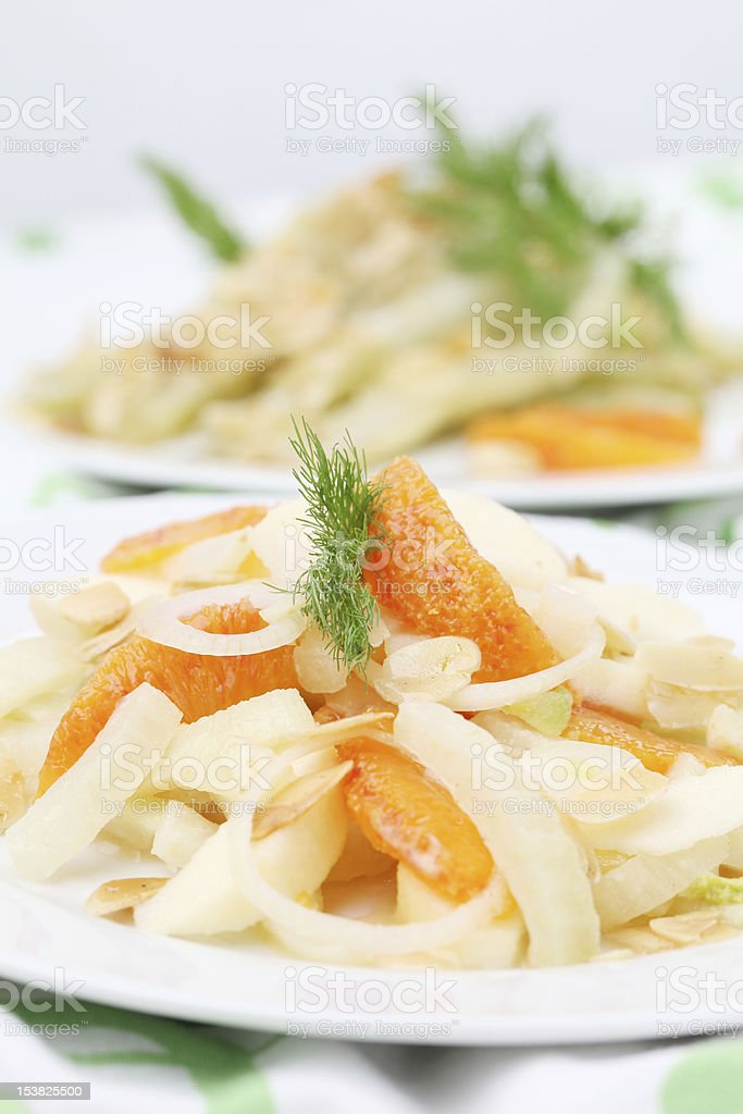 Fennel salad with oranges, almonds and apples royalty-free stock photo