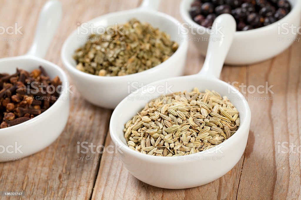 Fennel seeds and assorted bowls of spices royalty-free stock photo