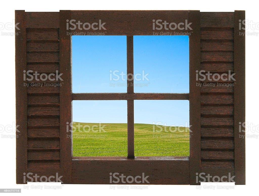 Fenster mit Aussicht auf eine Feldlandschaft stock photo