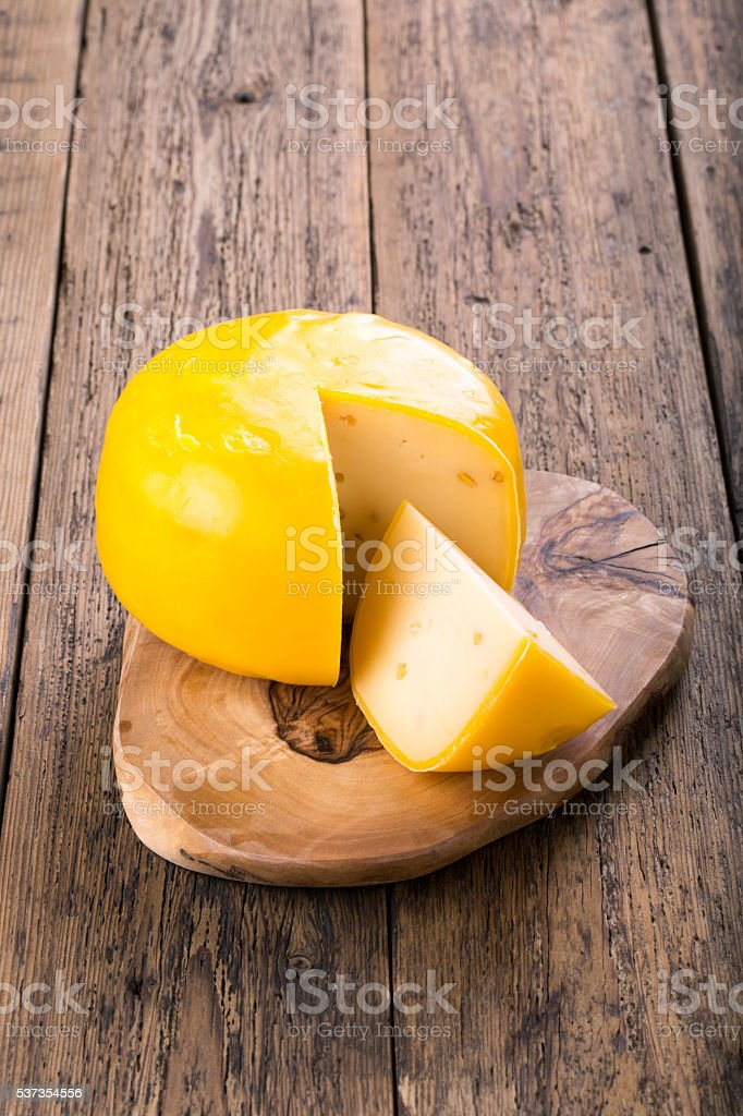 Fenugreek gauda herb cheese stock photo