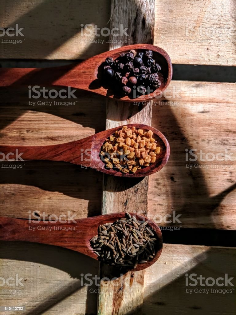 fenugreek, pepper, cumin seeds stock photo