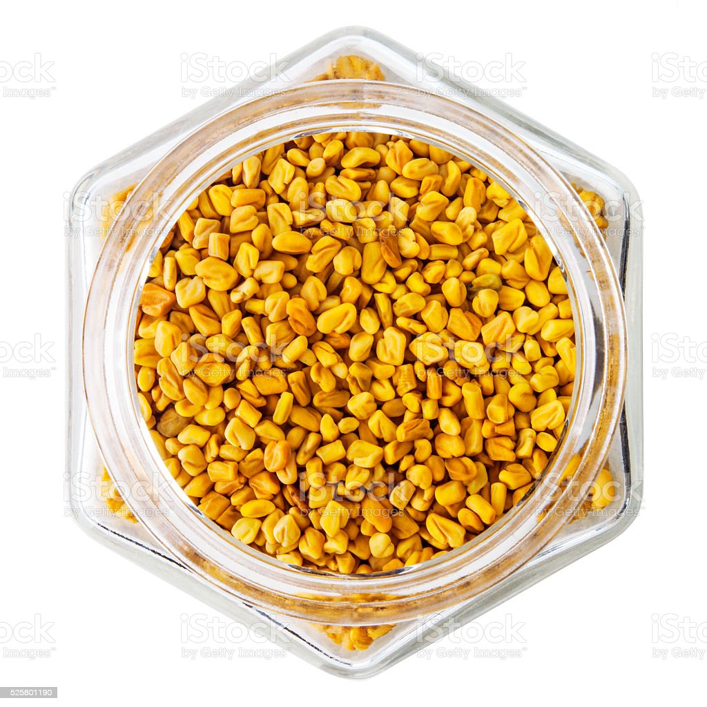 Fenugreek seeds isolated on white  background stock photo