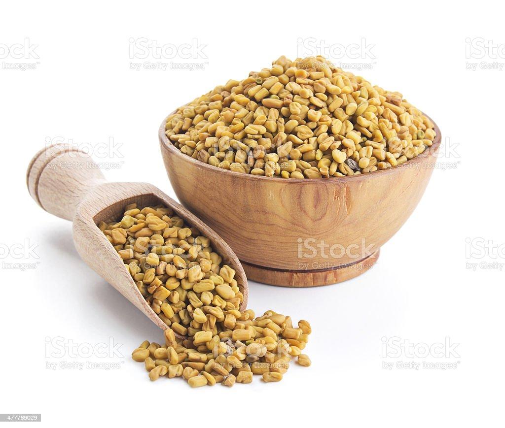 fenugreek seeds isolated on white stock photo
