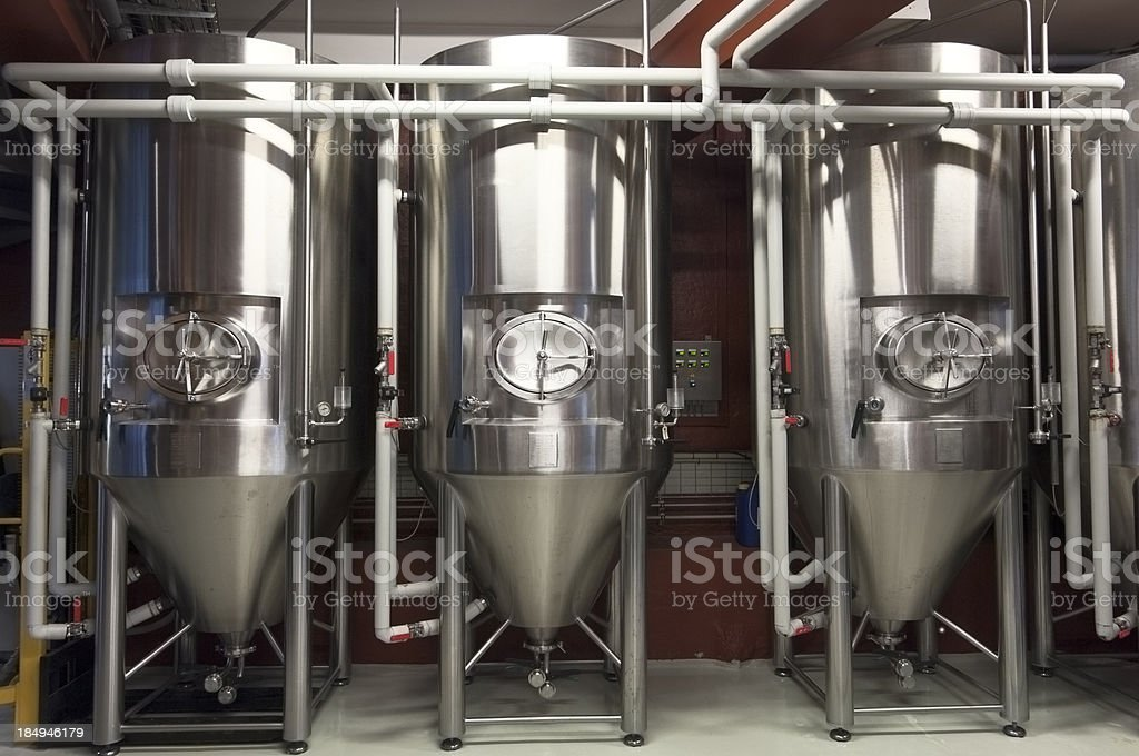Fermentation Tanks In a Micro Brewery royalty-free stock photo