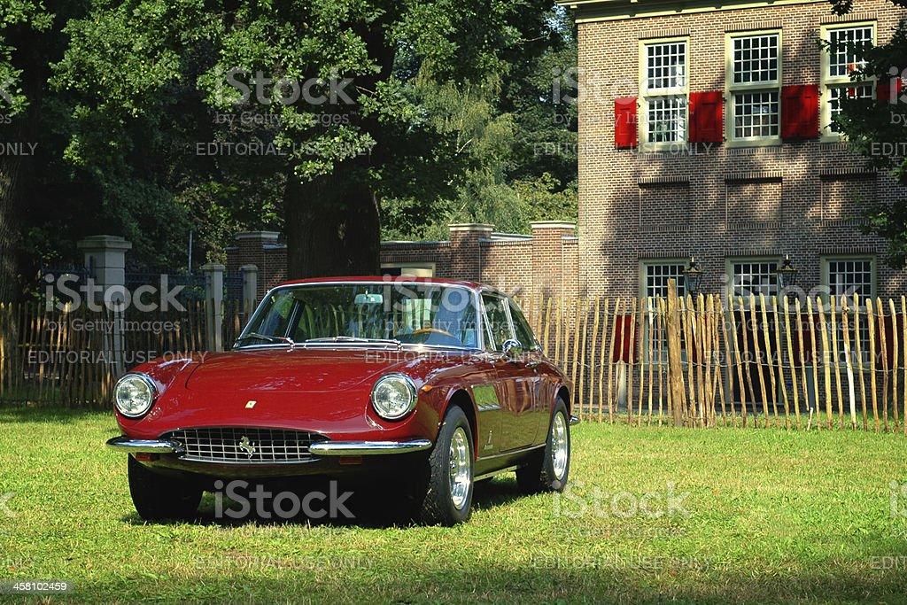 Ferrari 330 GTC classic Italian sports car in a field royalty-free stock photo