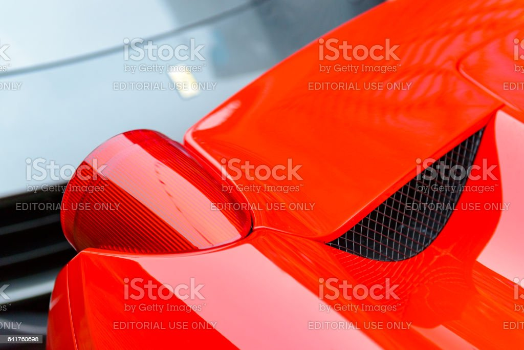 Ferrari 458 Italia rear light detail with an F12Berlinetta stock photo