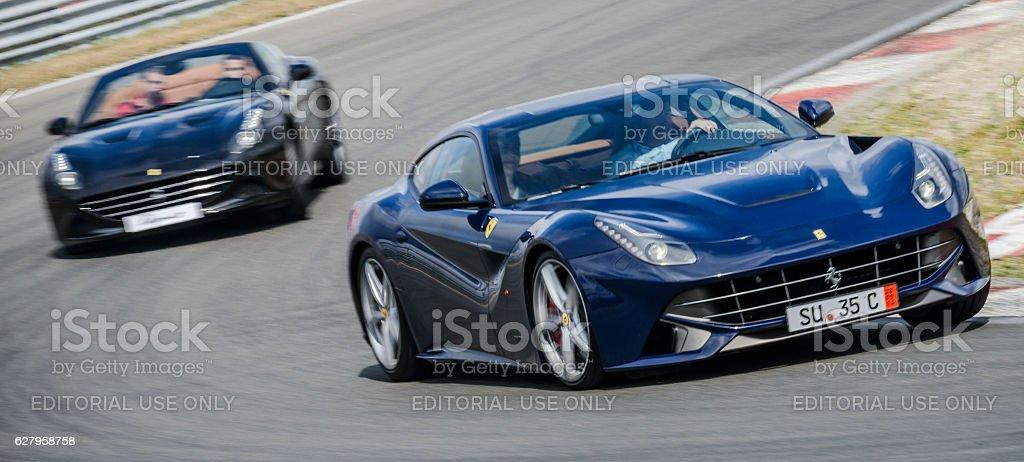 Ferrari F12 Berlinetta and Ferrari California T sports cars stock photo