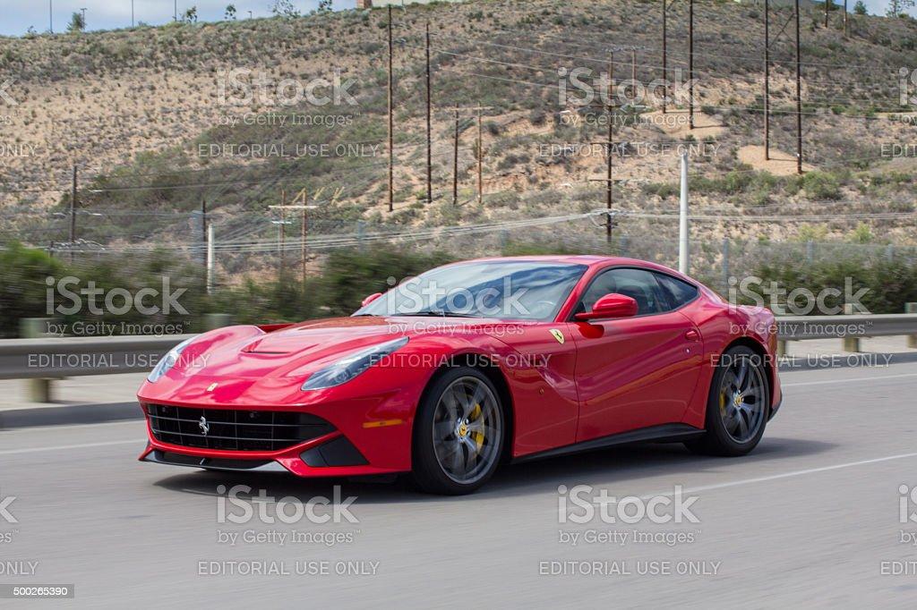 Ferrari F12 Berlinetta V12 GT sports car driving stock photo