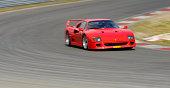 Ferrari F40 classic 1980s Italian supercar driving on track