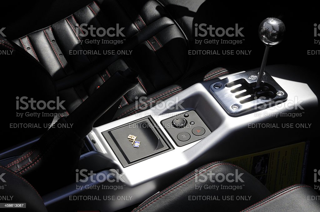 Ferrari F430 black leather interior with the iconic gear shift stock photo