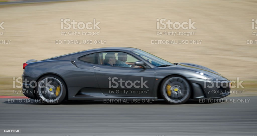 Ferrari F430 sports car driving at high speed stock photo