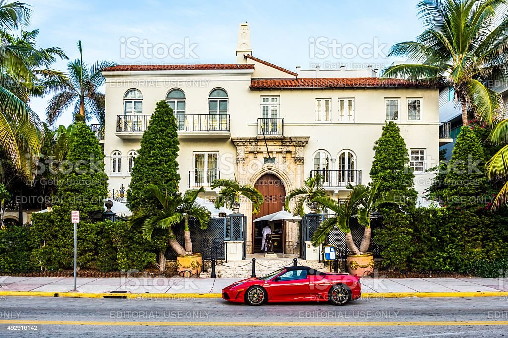 Ferrari in front of Versace mansion stock photo