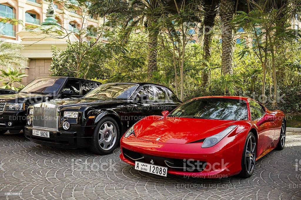 Ferrary 458 Italia and Rolls Royce Phantom stock photo