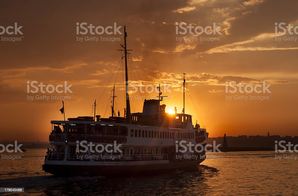 Ferries are moving at sunset stock photo