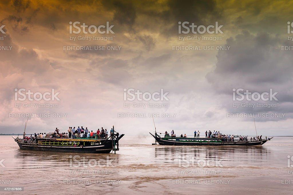 Ferries cross the Brahmaputra, Assam, India. stock photo