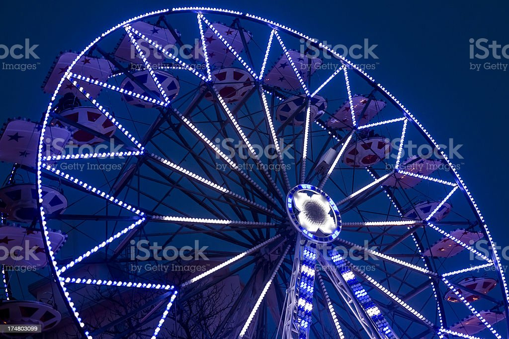 Ferris wheel against deep blue sky royalty-free stock photo