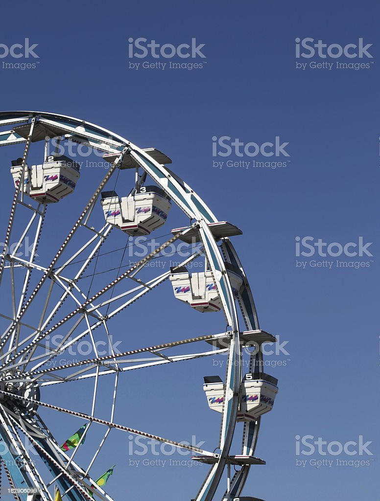 Ferris wheel and blue sky.  Vertical.  Copy space. royalty-free stock photo
