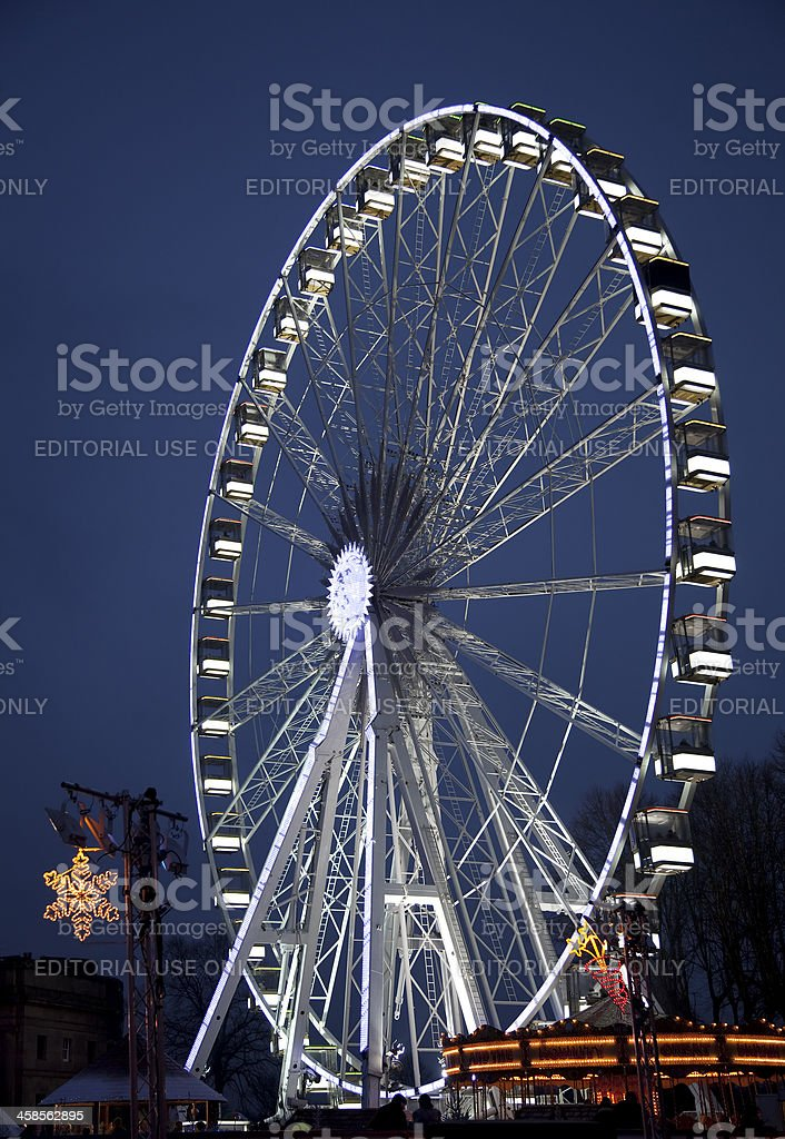 Ferris wheel and carousel at night royalty-free stock photo
