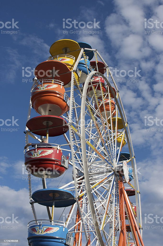 Ferris Wheel and clouds. royalty-free stock photo
