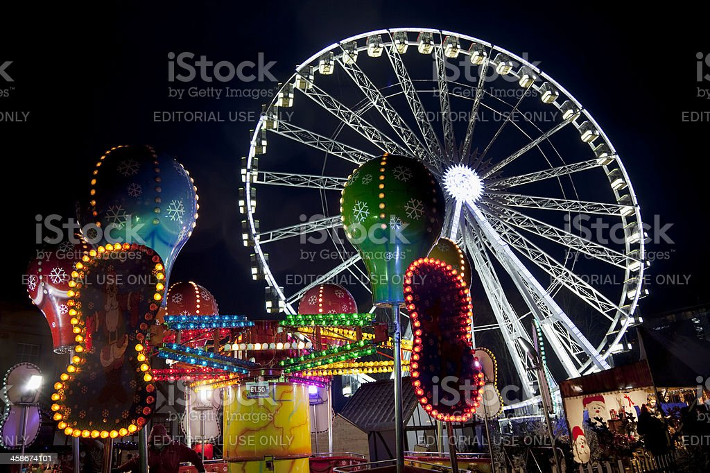 Ferris wheel and fairground at night royalty-free stock photo