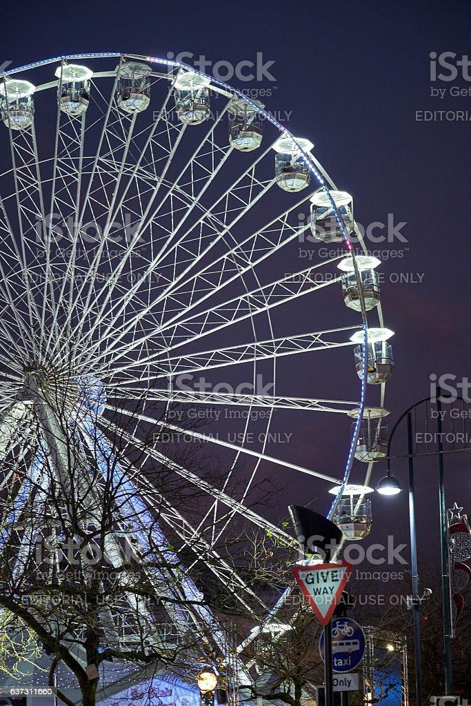 Ferris wheel and food stores at night in Birmingham, UK stock photo