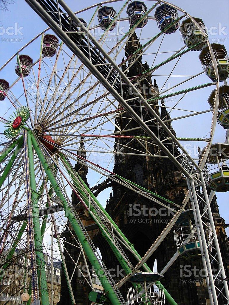 Ferris Wheel and Gothic Church royalty-free stock photo