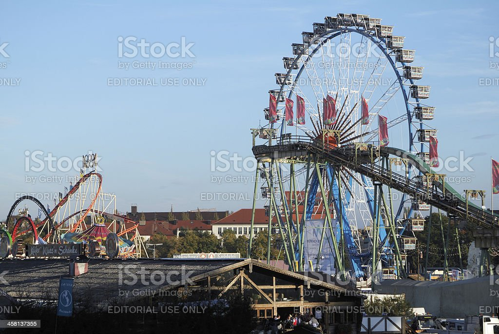 Ferris wheel and roller coaster at the Oktoberfest royalty-free stock photo