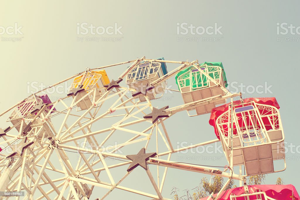 Ferris wheel and sky with retro filter effect (vintage style) stock photo
